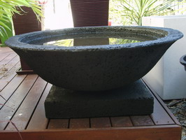 large garden water bowl with plant on base, black lava stone finish