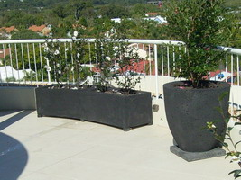 curved roof top garden planter troughs, black lava stone finish