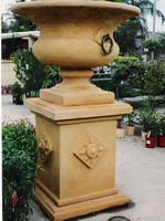 Semi classic urn and pedestal with bronzed rings, aged terracotta semi formal finish