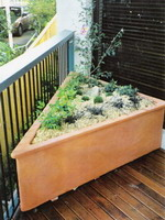 custom made triangle corner planter troughs and pot, aged terracotta semi formal finish