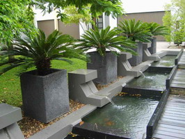 custom made commercial large square planters, charcoal lava stone finish