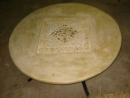 Custom round garden table, Mottle Ivory rust finish with lava stone relief, on wrought iron base