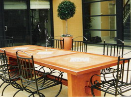 Tuscan courtyard table, kwela edge, terracotta and tile panels, curved terracotta legs and timber cross braces and wedges
