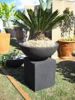 Semi formal finish bowl and plinth feature planter. Charcoal finish.